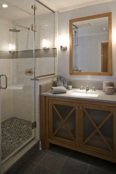 Shower tile work matched with a darker slate bathroom floor. Don't like the shower floor.
