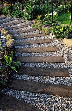 Railroad ties and pea gravel! <3 Maybe instead of concrete up to the house from the driveway?