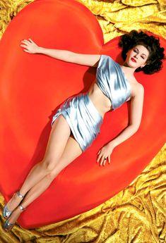 Yvonne De Carlo lying on a giant red heart circa 1950