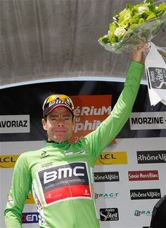 BMC's Cadel Evans, celebrates on the podium, with the green jersey, after the sixth stage of the 64th Dauphine cycling race, Saint-Alban-Leysse-Morzine, in Morzine, French Alps, Saturday, June 9, 2012.