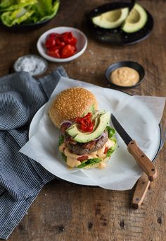 Boerewors burger with avocado, bacon & peppadew adds a South African twist to the recipe South African Recipes, Ethnic Recipes, Roasted Cabbage Wedges, Burger Toppings, Burger Buns, Salmon Burgers, Vegetable Recipes, Avocado, Kitchens