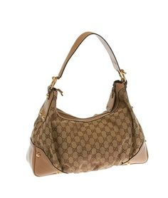 Gucci Gg Canvas & Leather Jockey (19138) Hobo Bag. Hobo bags are hot this season! The Gucci Gg Canvas & Leather Jockey (19138) Hobo Bag is a top 10 member favorite on Tradesy. Get yours before they're sold out!