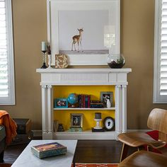 Cool non-working fireplace idea: Add a shelf. Then fill it with books, frames, candles, or whatever you want. Don't forget the pop of color.
