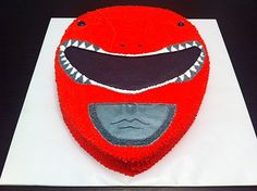 Darrick contacted us a few months back about doing a red Power Ranger birthday cake for his son. He wanted a vanilla cake with buttercream icing to feed 20. We began by baking a 11×15 sheet cake a…