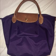Authentic Longchamp (short handle) Authentic, purple, & gently used short handle bag. Some white marks on the back of the bag but not very noticeable and wear on corners. Open to offers! Longchamp Bags