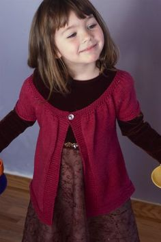 Love the style and color of this hand-knitted sweater for young ones.