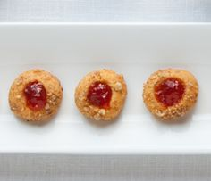 If you're heading to a pot luck this holiday season, bring these Cheddar Shortbread Cookies with Red Pepper Jelly.
