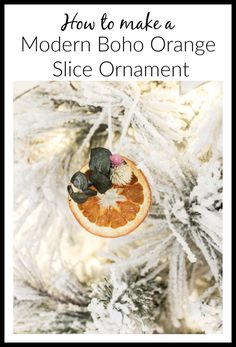 Learn how to make these modern boho dried floral orange slice ornaments- they\'re so easy and inexpensive!