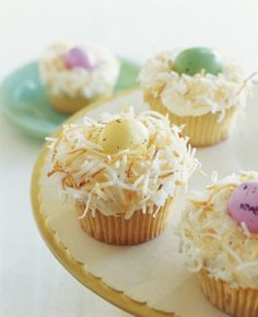 Easter Cakes: Easter Egg Nest Cupcakes - Toasting the coconut that forms the nests adds a natural straw color as well as a pleasant crunch and nutty flavor to these whimsical cupcakes. Easter egg candies come in many different sizes; use as many as will comfortably fit in each nest.