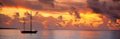 """Boat at sunset"" - canvas print by Panoramic Images"
