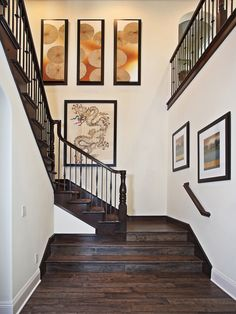 Ideas for large wall - don't like the paintings per say, but the placement of them is interesting.