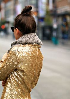 Top knot, cozy scarf, gold sequins: all things awesome.