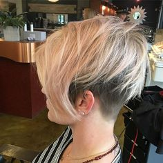 WEBSTA @ katiezimbalisalon - Such a cool chick! This blonde is infused with pastel lol, anyway, love the texture and the undercut!