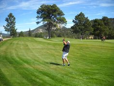 Playing golf at the Estes Park 9 hole.