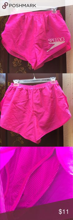 "Hot pink exercise shorts by Speedo Hot pink (first two photos are showing true color; lighting was off for other photos) - mesh underlining - very breathable - large, white ""Speedo"" logo on left side - elastic waistband - small inside pocket - good for running - lightly used Speedo Shorts"