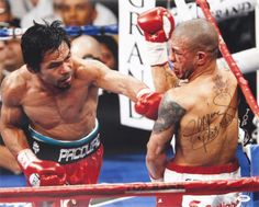 "Manny Pacquiao (Boxing) vs Miguel Cotto with ""Pacman"" Autographed Photo (Hand Signed Collectable) Photo from AllPosters.com"