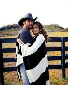 I want an engagement photo like this, only beach themed. love Tim McGraw and Faith Hill