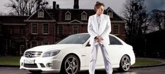 James Martin proudly stands in front of his C63 AMG.