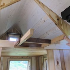 The ladder is kept hidden in a slot beneath the floor of the loft and can be slid out and dropped down when needed. Owl Creek Happenings: Tumbleweed Tiny House II