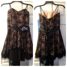Strapless Black Lace Semiformal Dress Short Black and Tan strapless Semiformal dress with beautiful lace pattern on top layer. Has black embellished belt that ties in the back, and back zipper. Has rubber lining support to help keep the dress up. In great condition, only worn once! This item is $30 but I will do $25 for discounted shipping! NO trades NO PayPal B Ware Dresses Strapless