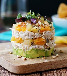 Kiwi and avocado chicken salad is stacked with layers of flavor from the creamy avocado to the garlicy shredded chicken and sweet nuggets of SunGold kiwi and orange.