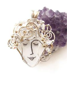 Sea Glass Jewelry Sea Glass Pendant Angel Face  $88.00   lots of ideas with this inspiration--maybe line drawings from photos?