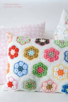 this is so pretty..  If you fall in love with making hexagons, why not turn them into a beautiful cushion?.. free pattern .... http://www.yvestown.com/blog/2013/9/african-flower-crochet-pattern