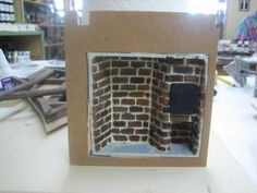 fireplace assembly, ready to glue into foam board structure .