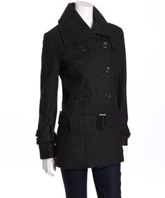 A fashionable and functional coat is always a warm welcome to any winter wardrobe. With a bold collar, off-center button closure and low-sitting belt, this posh peacoat is perfect for layering over everyday ensembles.60% cotton / 40% polyesterMachine wash; tumble dryImported