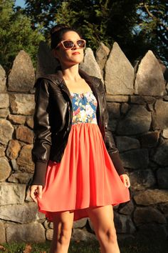 toughen up a feminine dress with a leather jacket