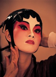 cocoroachchanel:    an actress at the chinese opera applying makeup inpreparationfor aperformance
