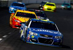 Jimmie Johnson Photos Photos - Jimmie Johnson, driver of the #48 Lowe's Chevrolet, leads a pack of cars during the Monster Energy NASCAR Cup Series O'Reilly Auto Parts 500 at Texas Motor Speedway on April 9, 2017 in Fort Worth, Texas. - Monster Energy NASCAR Cup Series O'Reilly Auto Parts 500