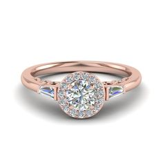 Kuvahaun tulos haulle rose gold round halo ring with baguette