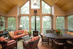 Baroque Lopi Wood Stoves convention Minneapolis Traditional Porch Image Ideas with cathedral ceiling corbels covered outdoor areas indoor-outdoor living metal railing SCREEN PORCH wicker porch