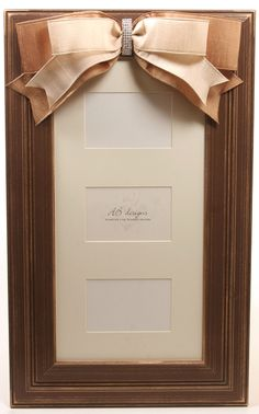 Handpainted picture frame with ribbon and brooch.
