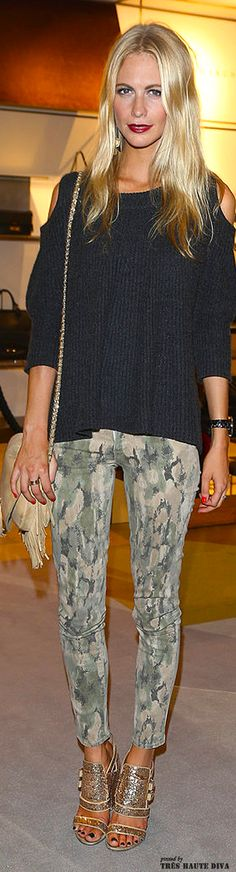 Poppy Delevigne in printed pants and gold heels