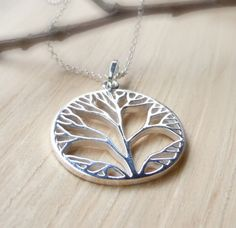 Wear a chic & symbolic Tree of Life Necklace by Camla