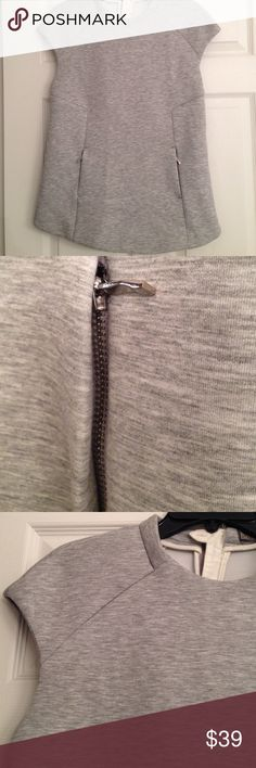 ZARA GREY STRUCTURED MODERN TOP Two zippers in front, cap sleeves, great seams, and a heavy (not quite scuba) fabric make this a great partner for skinnies, ankle cropped slim pants, or a pencil skirt. In excellent condition. BNWOT Zara Tops