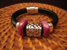 Black and pink licorice leather bracelet w/ hammered silver plated focal bead on Etsy, $40.00