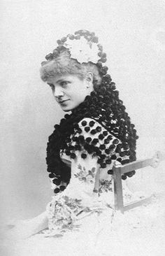 Infanta Eulalia of Spain, wears the world's most awesome pompom veil.