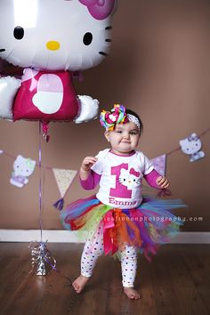 one year old girl in hello kitty picture in galion ohio photography studio
