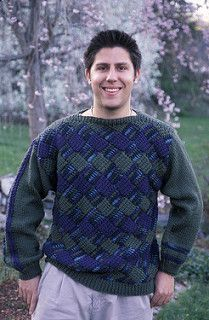 This Pattern is combines knitting and crochet in an interesting manner. The back and fronts are entrelac crochet and the sleeves are knitted.