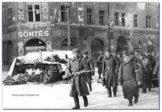 Red Army soldiers escort Hungarian POWs past a destroyed Jagdpanzer IV (Sd. in Budapest. January The Siege of Budapest December 1944 – 13 February Jagdpanzer Iv, Tank Warfare, Ww2 Pictures, Tank Destroyer, Story Of The World, Prisoners Of War, Red Army, German Army, War Machine