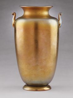 Gold Aurene Vase   LACMA Collections Steuben Glass Works (United States, New York, Steuben County, established 1903) United States, circa 1920s Furnishings; Accessories Glass 11 5/8 x 7 1/8 x 6 3/8 in. (29.53 x 18.1 x 16.19 cm) Gift of Mrs. Scott Allen (M.79.148.1)