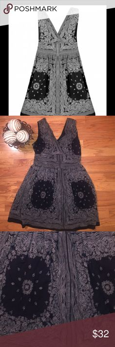Dark (navy/black) Bandana Dress Beautiful woven print sleeveless dress. With a surplus neckline in front and a v-neck in back 3 1/2 inches of defined waistband zipper in back. 39 inches flat Blue Plate Dresses Midi