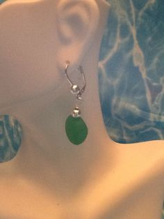 A personal favorite from my Etsy shop https://www.etsy.com/listing/240013977/green-sea-glass-with-silver-leverback