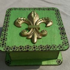 Box with fluer de lis medallion and burned details.