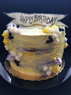 Yellow and purple birthday cake