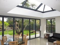 Take a look at this beautiful space featuring a roof lantern and bi-folding doors.