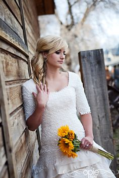 #wedding #dress #sleeves beautiful dress with sleeves and draped skirt and sunflower bouquet!